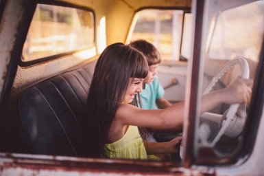 Girl and Boy in Old Truck.jpg