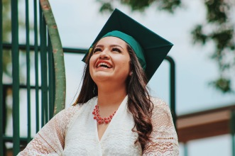 Girl Smiling With Graduation Cap.jpg